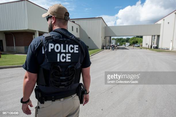 Immigration and Customs Enforcement's special agent preparing to arrest alleged immigration violators at Fresh Mark, Salem, June 19, 2018. Image...