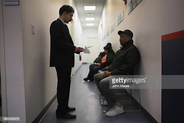 Immigration attorney Andres Lemons advises Dominican immigrant Bonifacio Guerrero Mesa his application to bring his family from the Dominican...