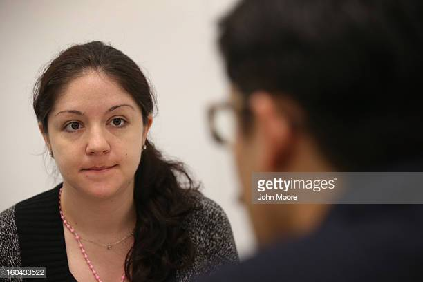 Immigration attorney Andres Lemons advises Evie Gomez on her US citizenship application on January 31 2013 in New York City The Canadian immigrant is...