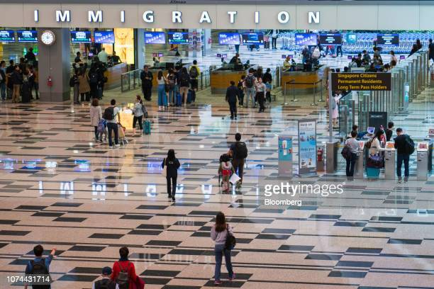 Immigration clearance counters stand at Terminal 1 of Changi Airport in Singapore on Thursday Dec 13 2018 Singapore'sChangiAirport...