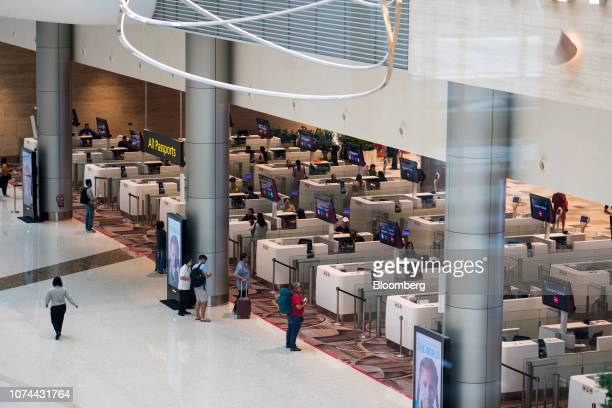 Immigration clearance counters stand in the departure hall at Terminal 4 of Changi Airport in Singapore on Thursday Dec 13 2018...