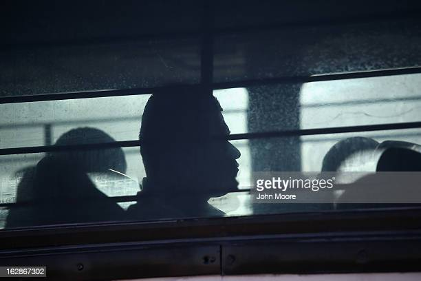 Immigration detainees from Honduras arrive by bus to board a deportation flight to San Pedro Sula Honduras on February 28 2013 in Mesa Arizona US...