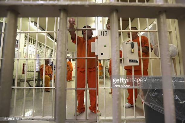 Immigration detainees stand behind bars at the Immigration and Customs Enforcement , detention facility on February 28, 2013 in Florence, Arizona....