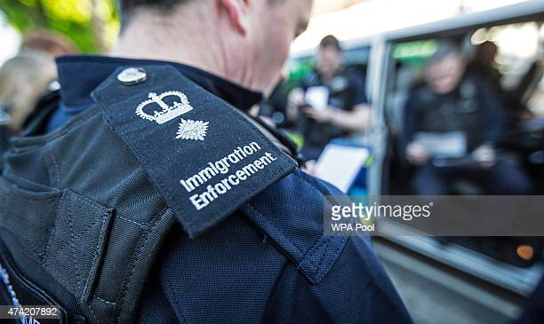 Immigration enforcement officers listen to a brief on the occupants of the houses they are about to raid for illegal immigrants on May 21 2015 in...