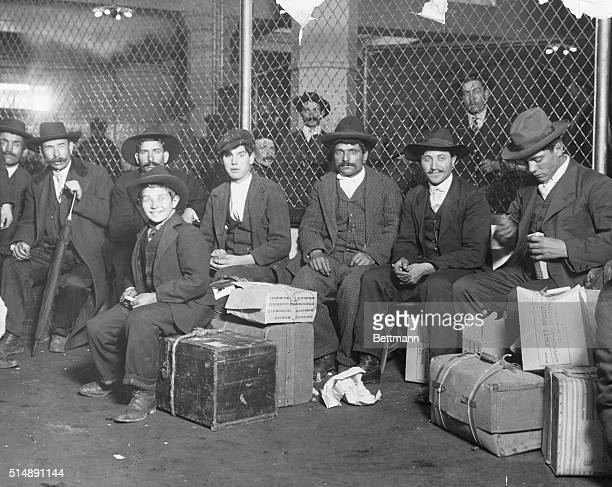 Group of Italian arrivals ready to be processed in Ellis Island Photograph by Lewis Hine