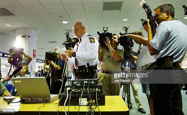 S Immigration Inspector Michael Soltis gives the media a demonstration of DataShare on a laptop computer July 2 2002 at Miami International Airport...