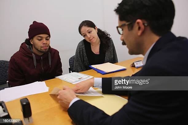 Immigration lawyer Andres Lemons advises Angel and Evie Gomez on their US citizenship application on January 31 2013 in New York City The married...
