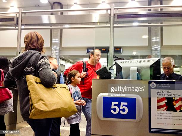 U.S. Immigration officer checking documents of tourists