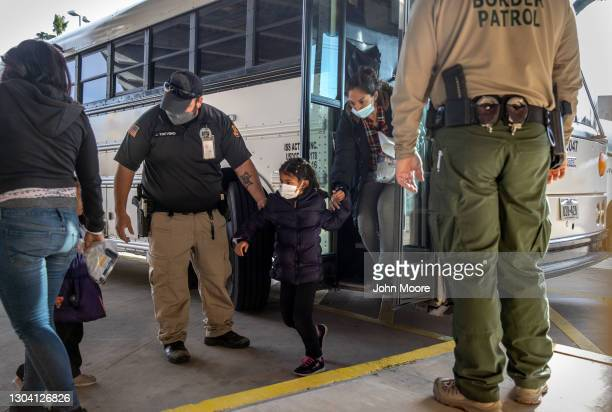 Immigration officers release asylum seekers at a bus station on February 25, 2021 in Brownsville, Texas. U.S. Immigration authorities are now...