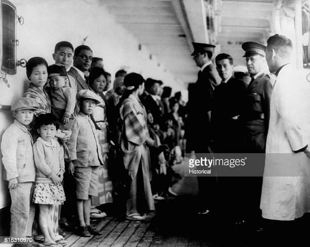 Immigration officials examine Japanese immigrants aboard the ship Shimyo Maru Angel Island California 1931