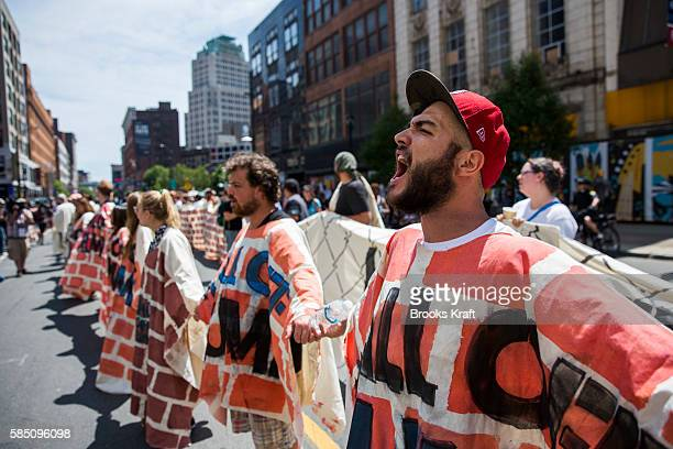 Immigration protestors opposed to Donald Trump's plan to build a new border wall protest in front of Quicken Loans Arena on the third day of the...