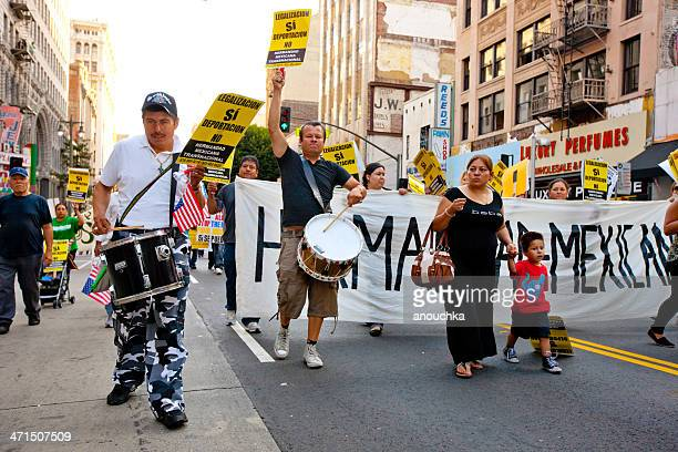 immigration reform march, may day, los angeles - mexican poster stock photos and pictures