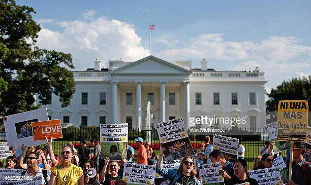 Immigration reform protesters gather in front of the White House on July 17 2014 in Washington DC The protest was organized by Amnesty International...