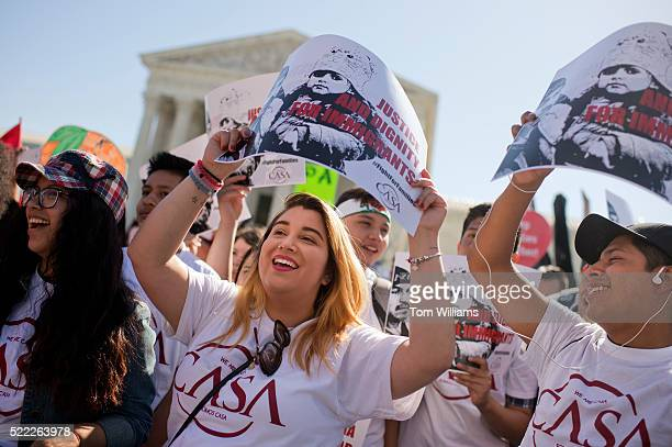 Immigration reform supporters rally outside of the Supreme Court as oral arguments are heard on President Obama's executive actions which would help...