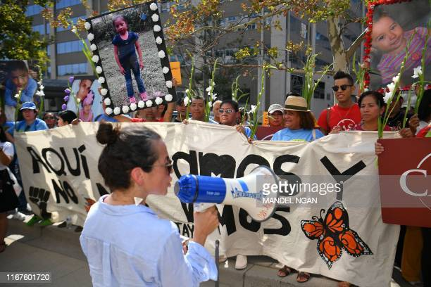 Immigration rights activists take part in a demonstration outside of US Immigration and Customs Enforcement headquarters in Washington, DC on...