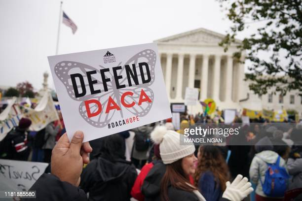 Immigration rights activists take part in a rally in front of the US Supreme Court in Washington DC on November 12 2019 The US Supreme Court hears...