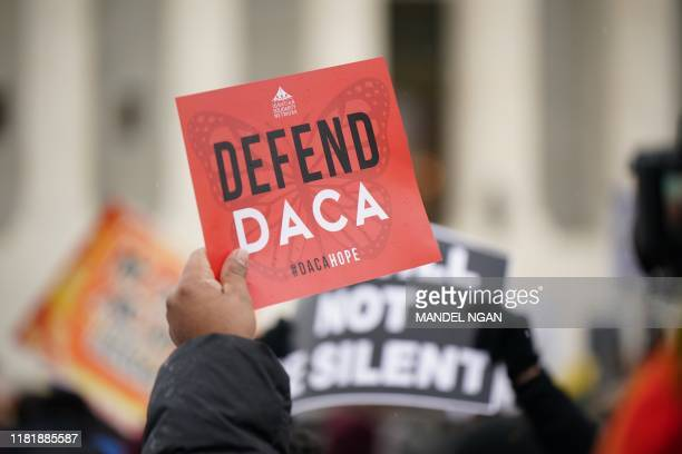 Immigration rights activists take part in a rally in front of the US Supreme Court in Washington, DC on November 12, 2019. - The US Supreme Court...