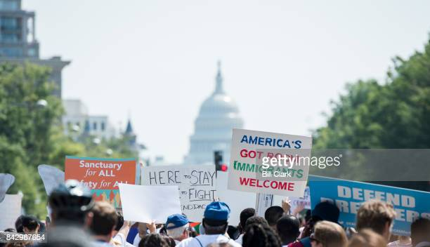 Immigration rights demonstrators march from the White House down Pennsylvania Avenue to the Trump Hotel and the Justice Department to oppose...