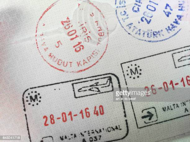 Immigration stamps on a passport