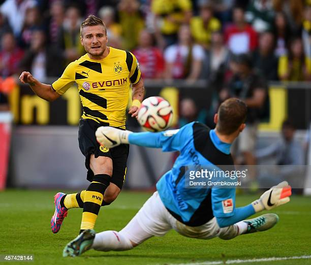 Immobile of Borussia Dortmund scores their first goal past Timo Horn of 1 FC Koeln during the Bundesliga match between 1 FC Koeln and Borussia...