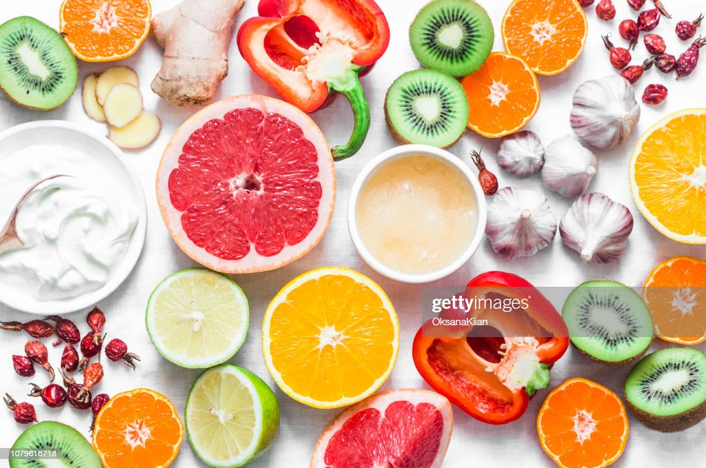 Immunity  boosting food set on a light background . Healthy lifestyle concept, winter prevention of colds. Flat lay, top view : Stock Photo