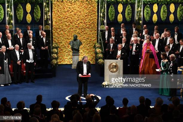 US immunologist and colaureate of the 2018 Nobel Prize in Physiology or Medicine James Allison poses with his Nobel Prize during the Award ceremony...