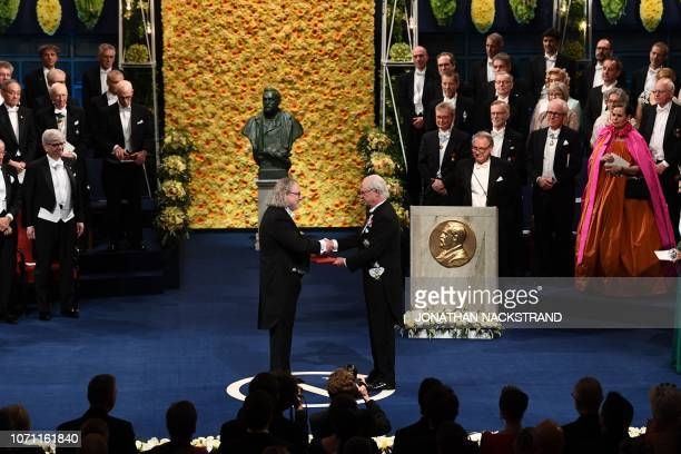US immunologist and colaureate of the 2018 Nobel Prize in Physiology or Medicine James Allison receives his Nobel Prize from King Carl XVI Gustaf of...