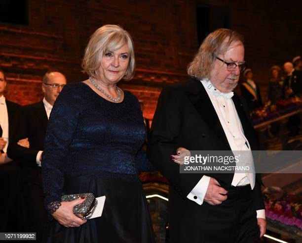 US immunologist and colaureate of the 2018 Nobel Prize in Physiology or Medicine James Allison and Sweden Prime Minister's wife Ulla Loefven arrive...