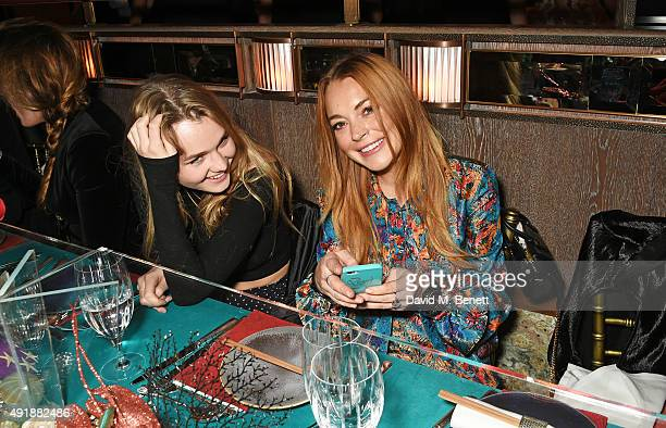 Immy Waterhouse and Lindsay Lohan attend the launch of Sexy Fish London in Berkeley Square on October 8 2015 in London England