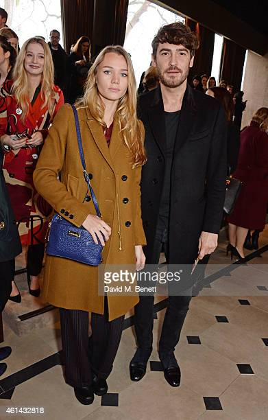 Immy Waterhouse and Robert Konjic attend the front row at Burberry Prorsum AW15 London Collections Men at Kensington Gardens on January 12 2015 in...