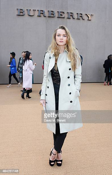 Immy Waterhouse arrives at the Burberry Prorsum AW 2015 during London Fashion Week at Kensington Gardens on February 23 2015 in London England