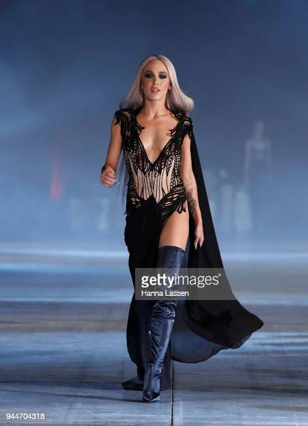 Imogen Anthony showcases designs by Sarah Joseph Couture during the Jurassic World Fallen Kingdom Runway Show on April 11 2018 in Sydney Australia