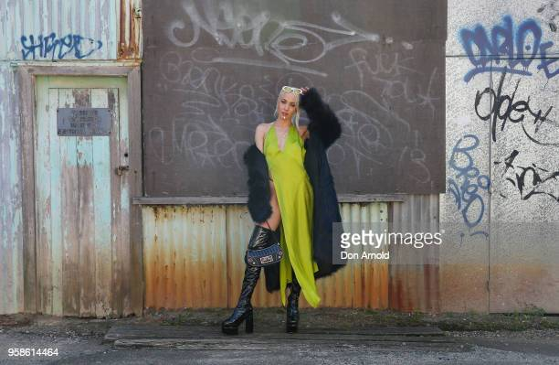 Imogen Anthony wears a dress by Wa La Land coat by Femme Fatale and boots by Sugar Baby during MercedesBenz Fashion Week Resort 19 Collections at...