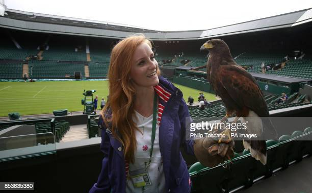 Imogen Davies with Rufus the 6 year old Harris Hawk who scares away pigeons away from centre court during day one of the Wimbledon Championships at...
