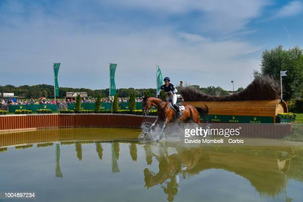 Imogen Murray of England riding Ivar Gooden during the obstacle in the water of the Cross Country test DHLPrize in the park of the CHIO of Aachen on...