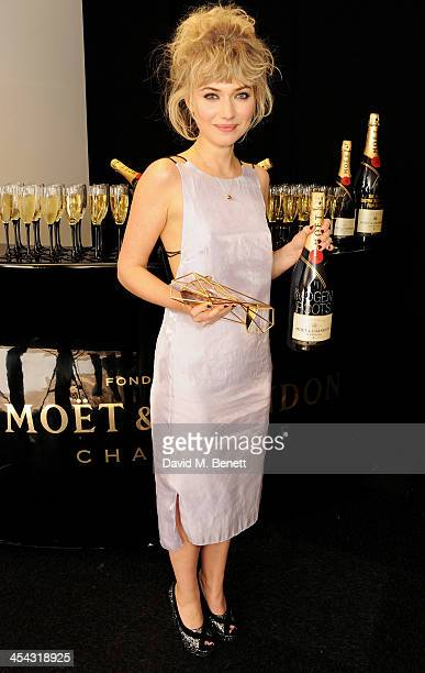 Imogen Poots winner of Best Supporting Actress for The Look of Love poses backstage at the Moet British Independent Film Awards 2013 at Old...
