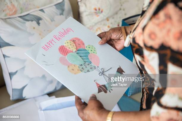 Imogen Robinson looks at a birthday card in her flat in Protheroe House in Tottenham on September 5 2017 in London England Protheroe House which...