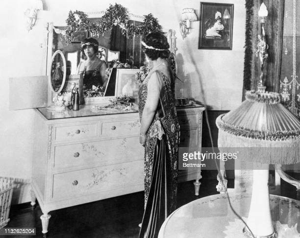 "Imogene Holmes Remus in her boudoir in the Remus dream house on the hill in Cincinnati, long before her husband killed her, ""because she made a fool..."
