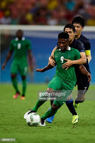 Imoh Ezekiel player of Nigeria battles for the ball with japan players during 2016 Summer Olympics match between Japan and Nigeria at Arena Amazonia...