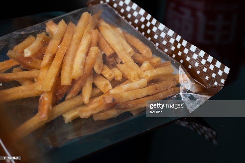 Imokenpi(sweet potato chips) Japanese snacks / potato coated with sugar : Stock Photo