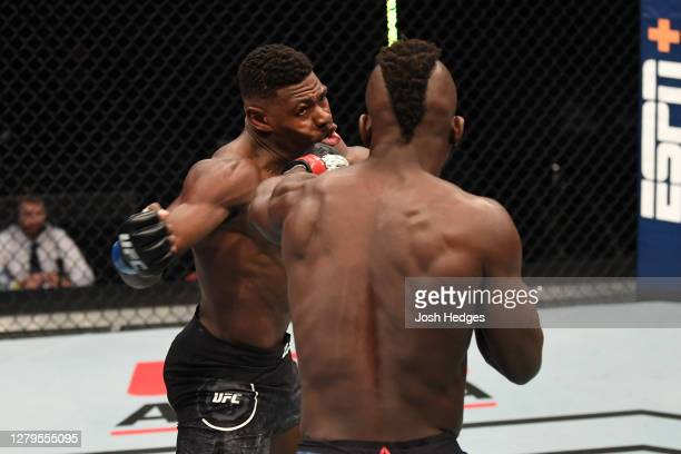 Impa Kasanganay punches Joaquin Buckley in their middleweight bout during the UFC Fight Night event inside Flash Forum on UFC Fight Island on October...