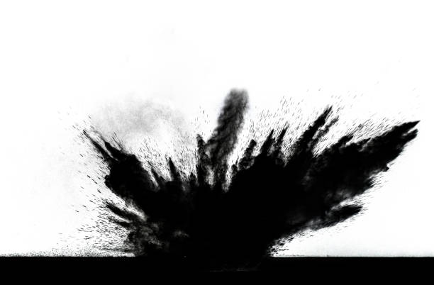 Impact and explosion of white dust and smoke particles on a black background.