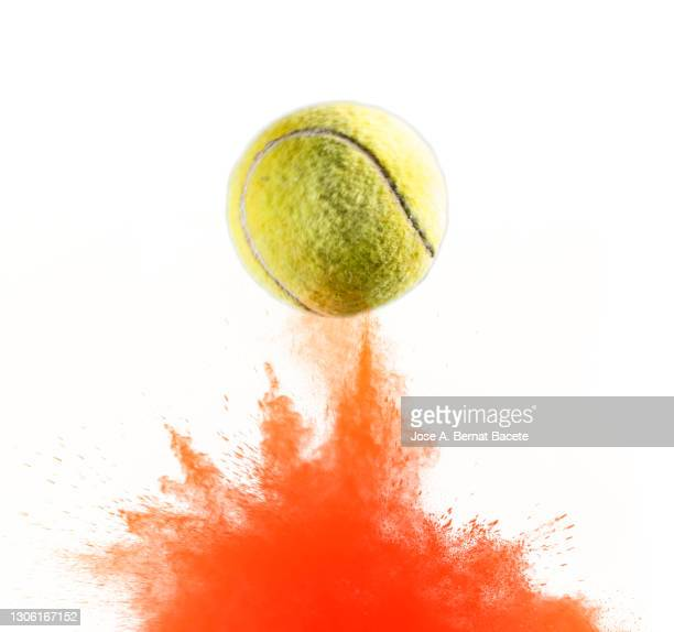 impact and rebound of a ball of tennis on a surface of land and powder on a white background - tennis racquet stock pictures, royalty-free photos & images
