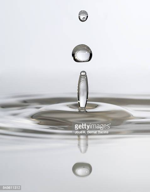 Impact and reflection of a water drop on a water surface