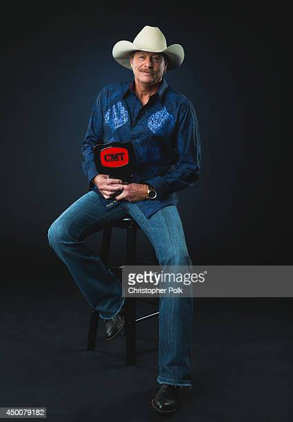 Impact Award winner Alan Jackson poses at the 2014 CMT Music Awards Wonderwall Portrait Studio at Bridgestone Arena on June 4 2014 in Nashville...