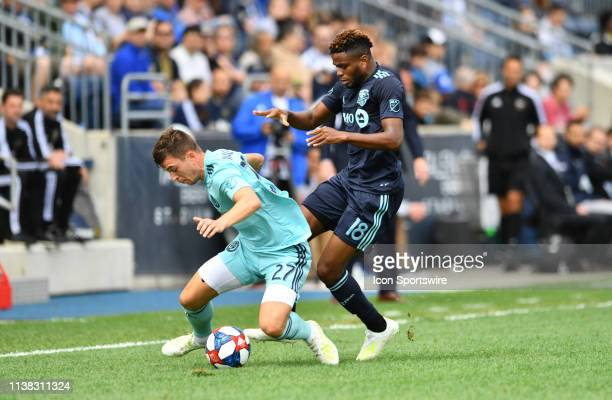 Impact Forward Orji Okwonkwo pushes Union Defender Kai Wagner to the ground in the first half during the game between the Montreal Impact and...