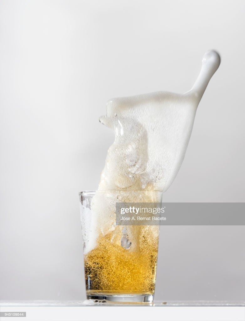 Impact of a glass with beer that falls down on the table. : Stock Photo