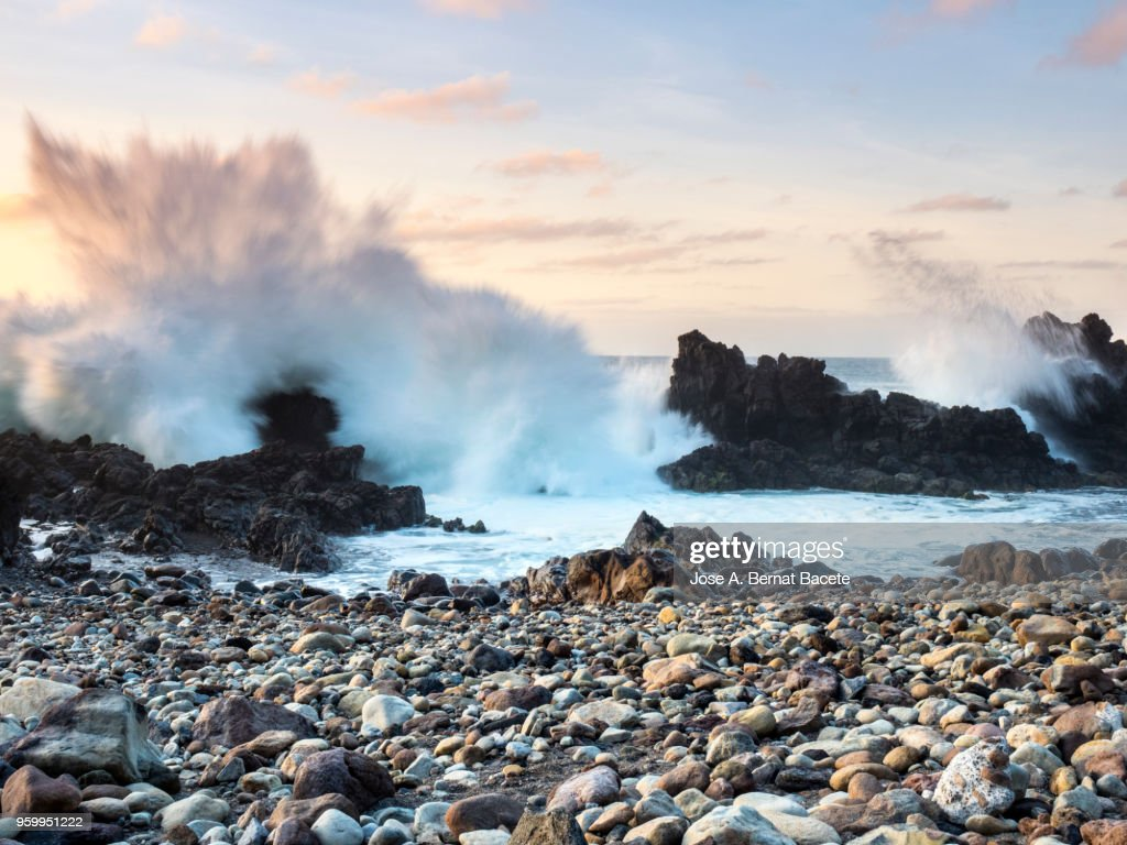 Impact of a great wave on the volcanic rocks of the coast or beach in Terceira Island in the Azores, Portugal. : Stock-Foto