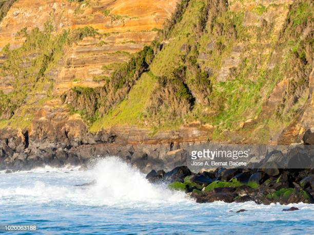 Impact of a great wave on the volcanic rocks of the coast or cliffs in Terceira Island in the Azores islands, Portugal.