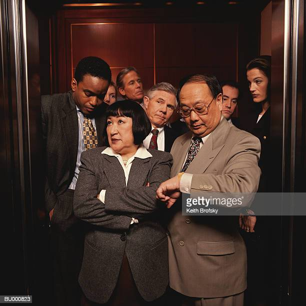Impatient Businesspeople in a Crowded Elevator